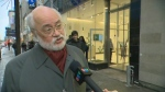 Andre Poulin of Destination Centreville explains why his organization has asked the SQDC to close its Ste. Catherine St. shop during the annual Santa Claus parade