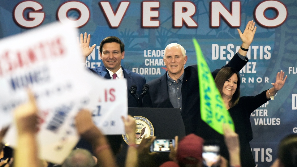 Florida Republican gubernatorial candidate Ron DeSantis waves to the crowd at his Jacksonville, Fla., campaign rally where he was joined by Vice President Mike Pence and his wife Karen Pence, Oct. 25, 2018. (Bob Self / The Florida Times-Union via AP)