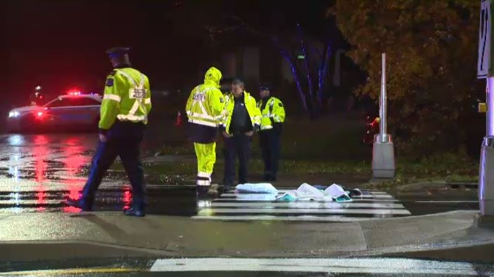 Halifax police investigate the scene of a bus-pedestrian collision on Portland Street in Dartmouth. The items on the road are first-aid supplies left behind by paramedics.