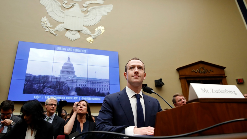 In this April 11, 2018 file photo, Facebook CEO Mark Zuckerberg returns after a break to continue testifying at a House Energy and Commerce hearing on Capitol Hill in Washington, about the use of Facebook data to target American voters in the 2016 election and data privacy. (AP Photo/Jacquelyn Martin, File)