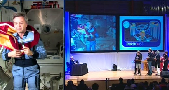 Astronaut Robert Thirsk, appearing before his audience in Calgary via video link from the International Space Station.