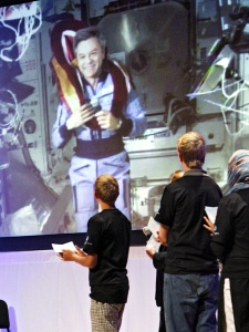 Astronaut Robert Thirsk wears his convocation hood after being granted an honorary degree, seen in Calgary via video link from the International Space Station, Wednesday, July 8, 2009. (Jeff McIntosh / THE CANADIAN PRESS)