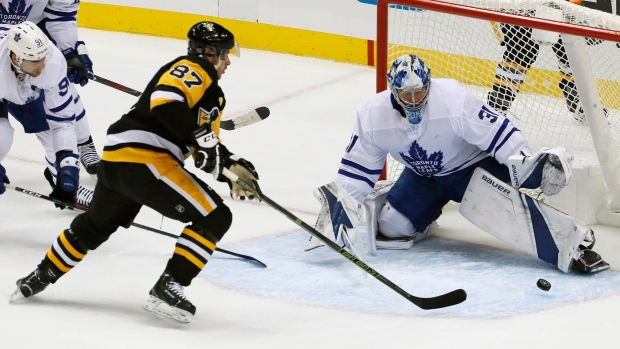 b9dc9285881 Pittsburgh Penguins  Sidney Crosby (87) can t get his stick on a rebound in  front of Toronto Maple Leafs goaltender Frederik Andersen (31) during the  first ...