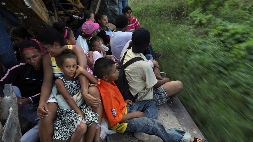 Central American migrants, part of the caravan hoping to reach the U.S. border, travel on a truck in Loma Bonita, Oaxaca state, Mexico, Saturday, Nov. 3, 2018. (AP Photo/Rodrigo Abd)