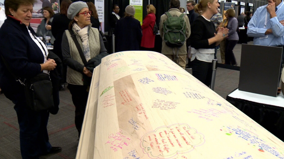 A coffin that people can sign is showed off at a death expo in Montreal, on Sunday, Nov. 4, 2018.