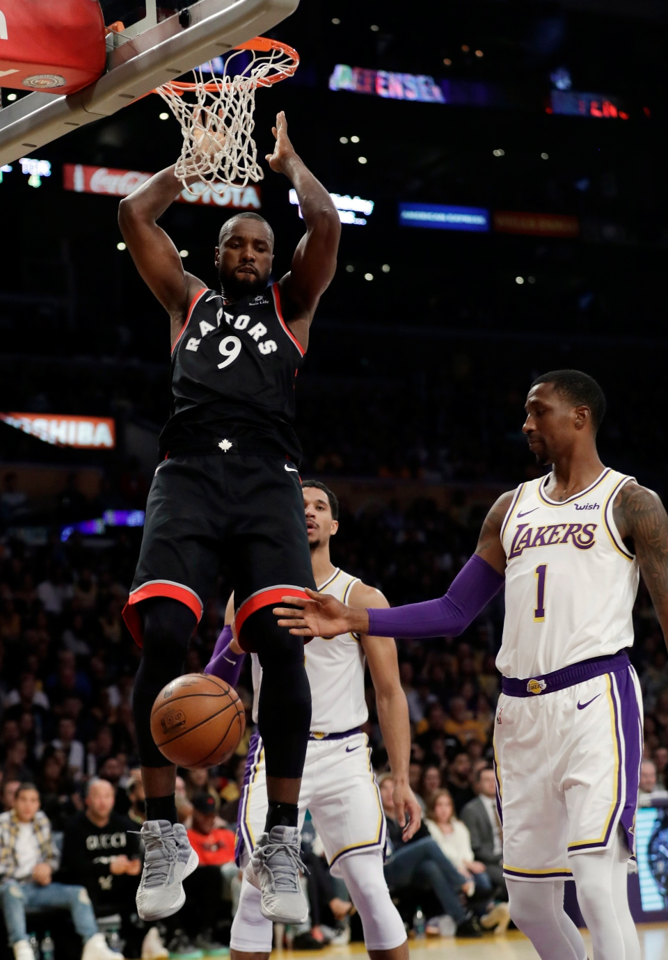 Toronto Raptors  Serge Ibaka (9) dunks against the Los Angeles Lakers  during the second half of an NBA basketball game Sunday 348d82898