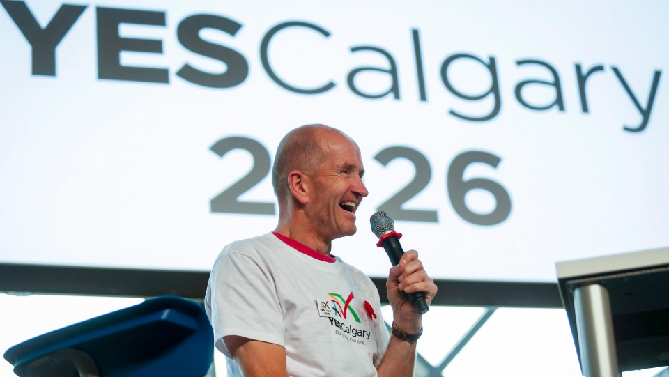 "Former Olympian Michael Edwards also known as ""Eddie the Eagle"" speaks during a rally in support of the 2026 Winter Olympic bid in Calgary, Alta., Monday, Nov. 5, 2018. (THE CANADIAN PRESS/Jeff McIntosh)"