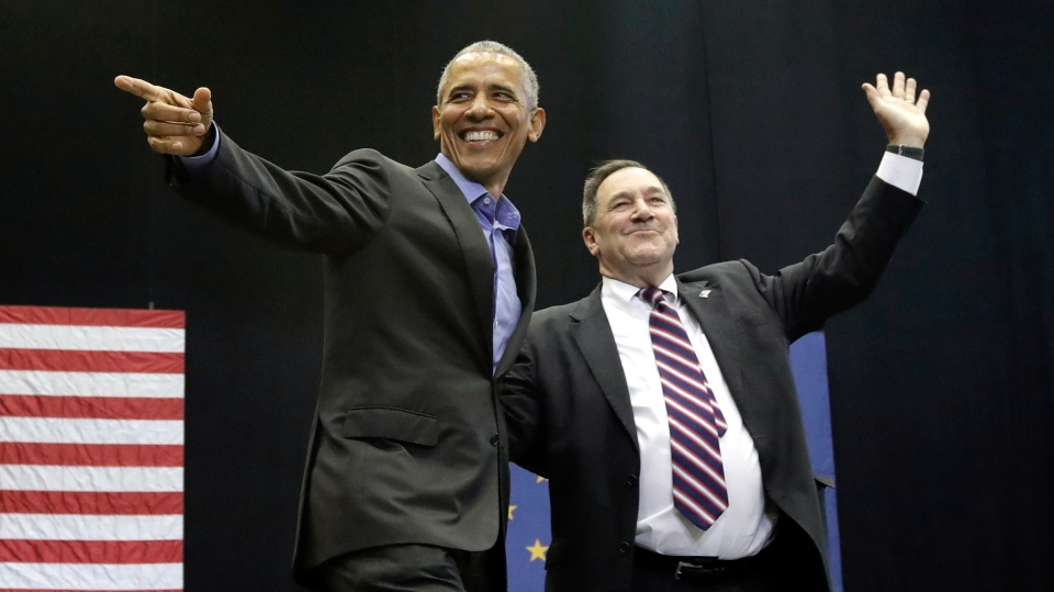 Former U.S. President Barack Obama, left, points as Democratic congressional candidate U.S. Sen. Joe Donnelly waves to the crowd during a campaign rally at Genesis Convention Center in Gary, Ind., Sunday, Nov. 4, 2018. (AP Photo/Nam Y. Huh)