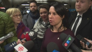 Montreal Mayor Valerie Plante talks to reporters in a metro station on the first anniversary of her election