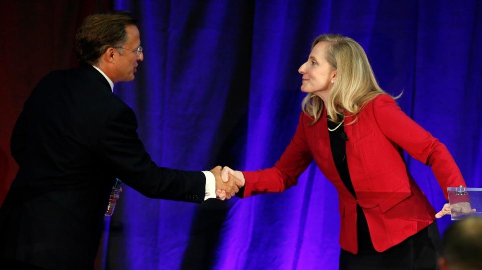 In this Oct. 15, 2018 photo, Virginia Congressman Dave Brat, R-Va., left, shakes hands with Democratic challenger Abigail Spanberger, right, after a debate at Germanna Community College in Culpeper, Va. The path to power in the House runs through a few dozen districts in Tuesday's election, with Republicans defending their majority and Democrats looking to gain 23 seats they would need to win control. (AP Photo/Steve Helber)