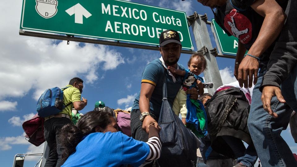 U.S.-bound Central American migrants get on to a truck for a a free ride, as part of a thousands-strong caravan moving through Puebla, Mexico, Monday, Nov. 5, 2018. (AP / Rodrigo Abd)