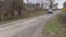 An OPP cruiser remains at the scene where three bodies were found in a vehicle in Middlesex Centre, Ont. on Monday, Nov. 5, 2018. (Brent Lale / CTV London)
