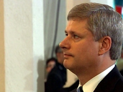 Prime Minister Stephen Harper stands during the funeral mass former governor general Romeo LeBlanc last week.
