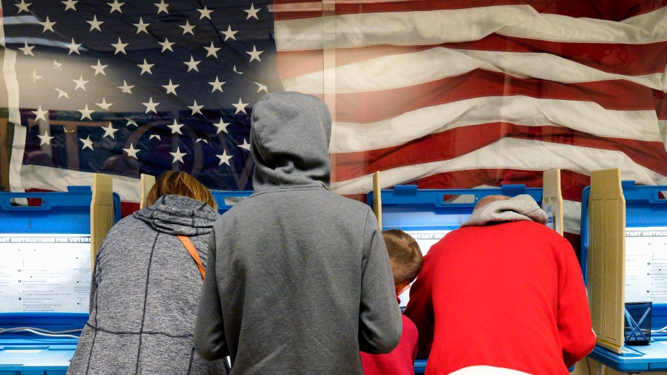 In this Nov. 2, 2018, photo residents vote early at the Douglas County Election Commission office in Omaha, Neb.(AP Photo/Nati Harnik, File)