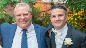 Top political staffer Andrew Kimber is seen in this undated Facebook photo with Ontario Premier Doug Ford.