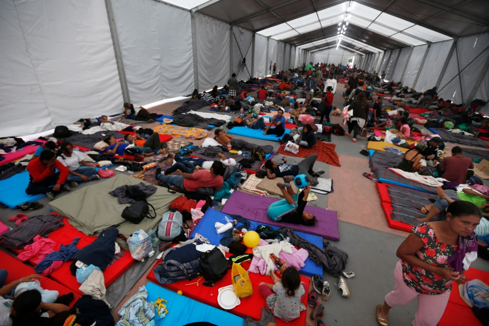 Central American migrants, part of a caravan hoping to reach the U.S. gets settled in a shelter at the Jesus Martinez stadium, in Mexico City, Monday, Nov. 5, 2018. (AP Photo/Marco Ugarte)