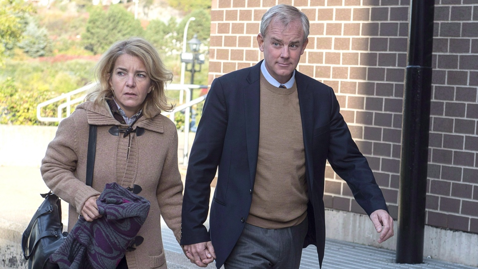 Dennis Oland and his wife Lisa arrive at Harbour Station arena in Saint John, N.B., on Monday, Oct. 15, 2018 for jury selection in the retrial in the bludgeoning death of his millionaire father, Richard Oland. THE CANADIAN PRESS/Andrew Vaughan