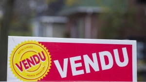 A sign meaning sold is shown on the west island of Montreal, Saturday, November 4, 2017. THE CANADIAN PRESS/Graham Hughes