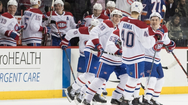 Montreal Canadiens right wing Joel Armia (40) celebrates after scoring the winning goal during the shootout of an NHL hockey game against the New York Islanders, Monday, Nov. 5, 2018, in New York. The Canadiens won 4-3. (AP Photo/Mary Altaffer)