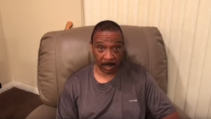 Marston Riley, a music teacher at Maywood Academy High School, is seen in this screengrab from a video posted on the GoFundMe page. (mrileygofundme / YouTube)
