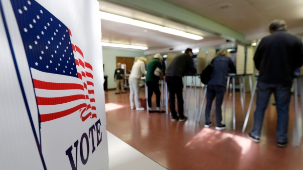 Voters cast their ballots, Tuesday, Nov. 6, 2018, in Gates Mills, Ohio. (AP Photo/Tony Dejak)