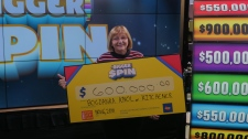 Bogdanka Knol holding a cheque for $600,000