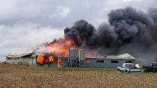 A barn engulfed in flames