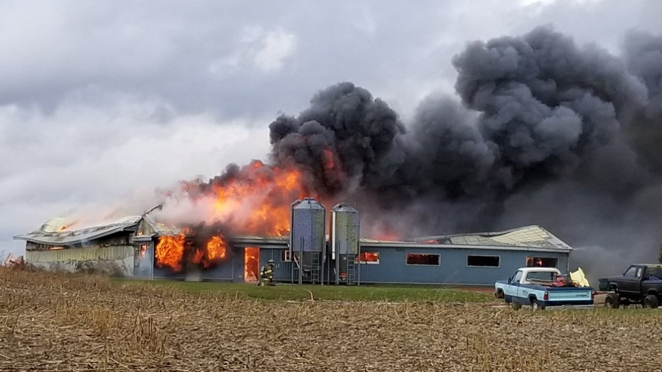 Police and fire services responded to a large barn fire on Tuesday afternoon. (@CharlesWCTO / Twitter)