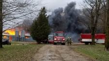 Firefighters battling a barn fire