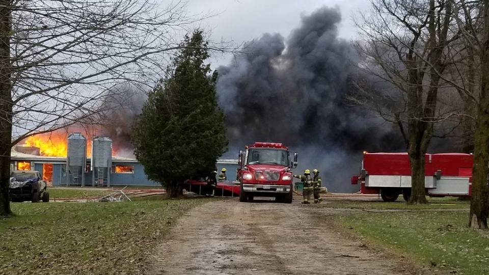 Firefighters seen at a barn fire. (@CharlesWCTO / Twitter)