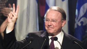 Bernard Landry, officially acclaimed leader of the Parti Quebecois, gives a victory sign as he is applauded as he takes the stage St-Hyacinthe, Que., Friday, March 2, 2001. Landry has died at age 81.THE CANADIAN PRESS/Paul Chiasson