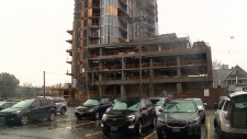 Cars parked beside construction site on Preston St