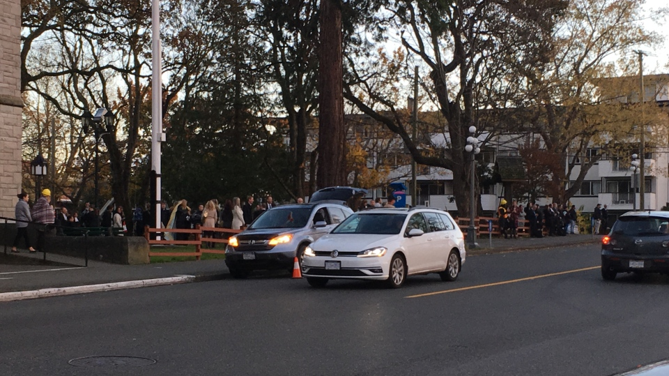 A large crowd of people congregated at a nearby church after a bomb threat forced the evacuation of the Victoria courthouse Tues., Nov. 6, 2018. (CTV Vancouver Island)