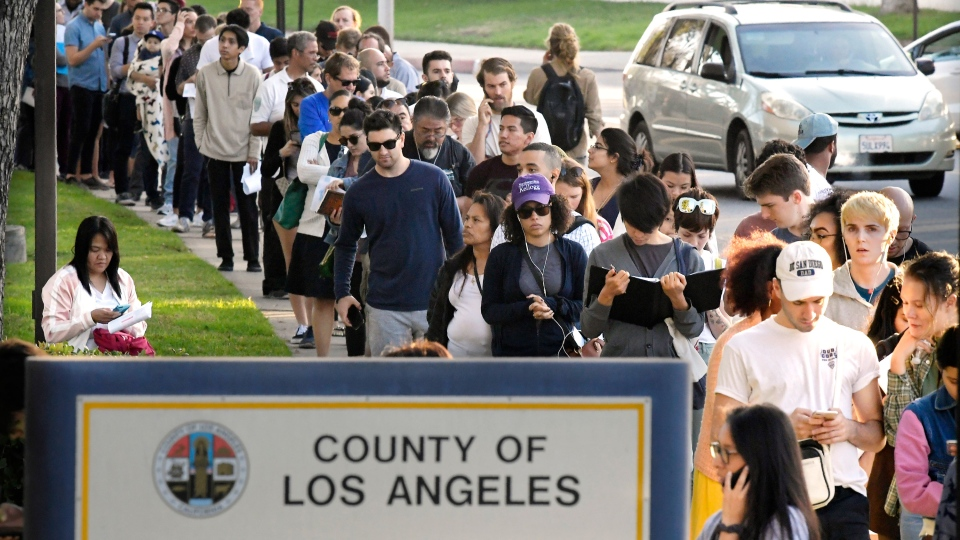 Potential voters wait in long lines to register and vote at the Los Angeles County Registrar's office Tuesday, Nov. 6, 2018, in the Los Angeles section of Los Angeles. (AP Photo/Mark J. Terrill)
