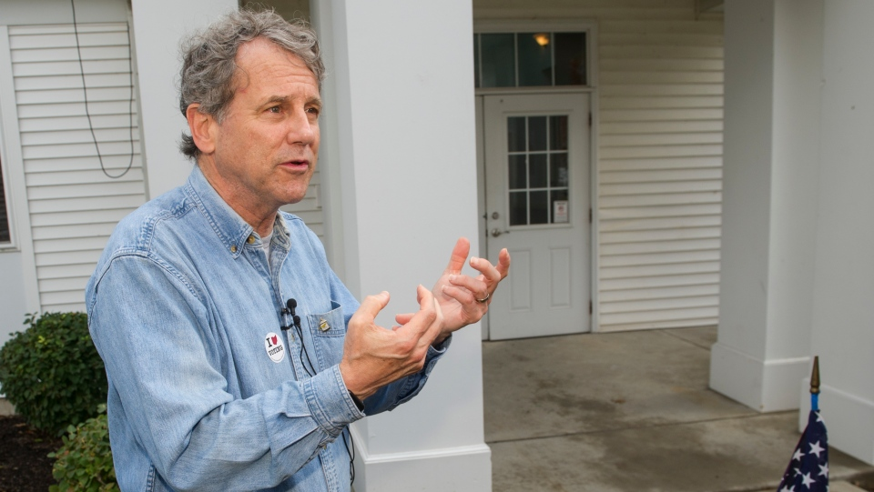 Sen. Sherrod Brown, D-Ohio, talks with reporters after voting Tuesday, Nov. 6, 2018, in Cleveland. (AP Photo/Phil Long)