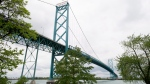 The Ambassador bridge is seen crossing the Detroit river from Windsor, Ont. on Friday, May 26, 2017. (THE CANADIAN PRESS/Adrian Wyld)