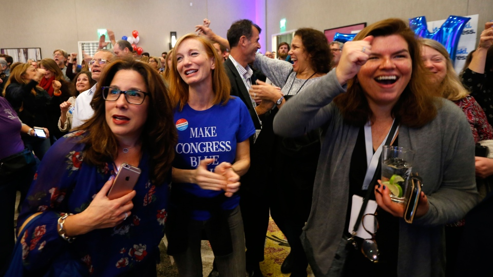 Supporters for Democratic congressional candidate Tom Malinowski react to election results during an election night watch party Tuesday, Nov. 6, 2018, in Berkeley Heights, N.J. (AP Photo/Noah K. Murray)