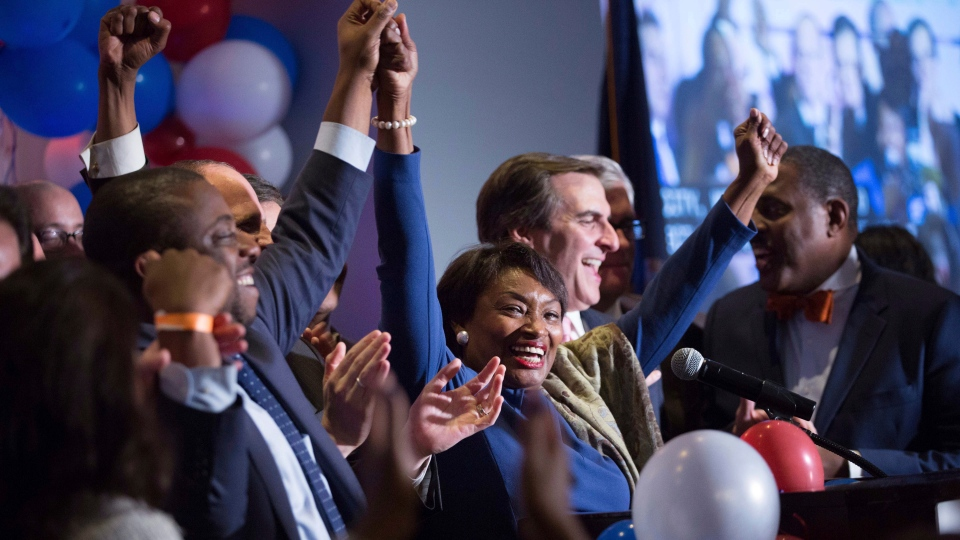 New York State Sen. Andrea Stewart-Cousins celebrates her re-election with other New York State Senate victors during the Nassau County Democratic Committee election night event Wednesday, Nov. 6, 2018, in Garden City, NY. Democrats retook both the U.S. House of Representatives and the New York State Senate in the midterm election. (AP Photo/Kevin Hagen)