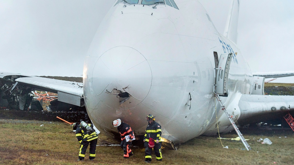 A SkyLease Cargo plane skidded off a runway at Halifax Stanfield International Airport and stopped near a road early on Wednesday, Nov. 7, 2018. (Andrew Vaughan / CANADIAN PRESS)
