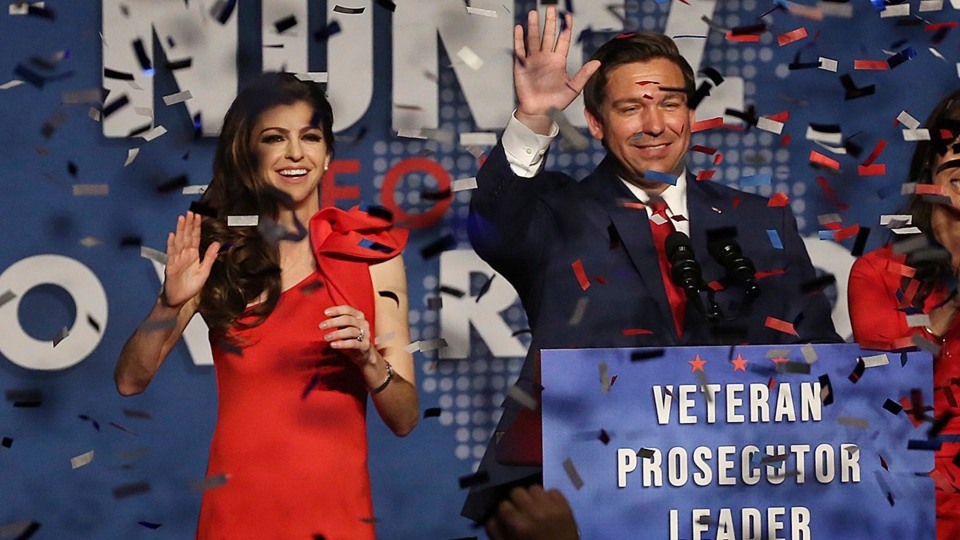 Ron DeSantis and his wife Casey celebrate after winning the Florida Governor's race during DeSantis' party at the Rosen Centre in Orlando on Orlando, Fla., on Tuesday, Nov. 6, 2018. (Stephen M. Dowell/Orlando Sentinel via AP)