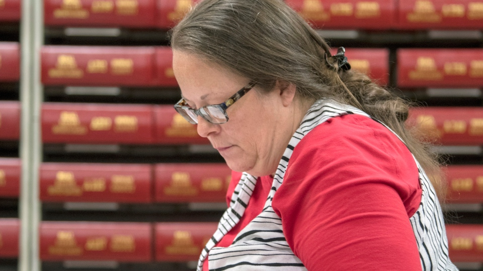 Kim Davis, the county clerk for Rowan County in Kentucky, works with the county election board on Election Day, Tuesday, Nov. 6, 2018, in Morehead, Ky. (AP Photo/John Flavell)