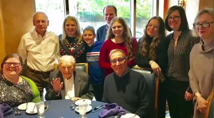 Robert Wiener, 110 taking a photo with members of his family. (provided)