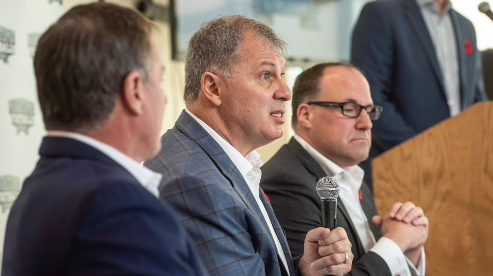 CFL commissioner, Randy Ambrosie, centre, speaks to reporters during a press conference with Maritime Football Limited Partnership founding partners Bruce Bowser, left, and Anthony LeBlanc in Halifax on Wednesday, November 7, 2018. (THE CANADIAN PRESS/Darren Calabrese)