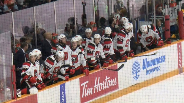 67's host school day game