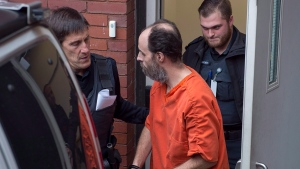 Matthew Vincent Raymond, charged with four counts of first degree murder, heads from provincial court in Fredericton on Monday, Nov. 5, 2018. THE CANADIAN PRESS/Andrew Vaughan