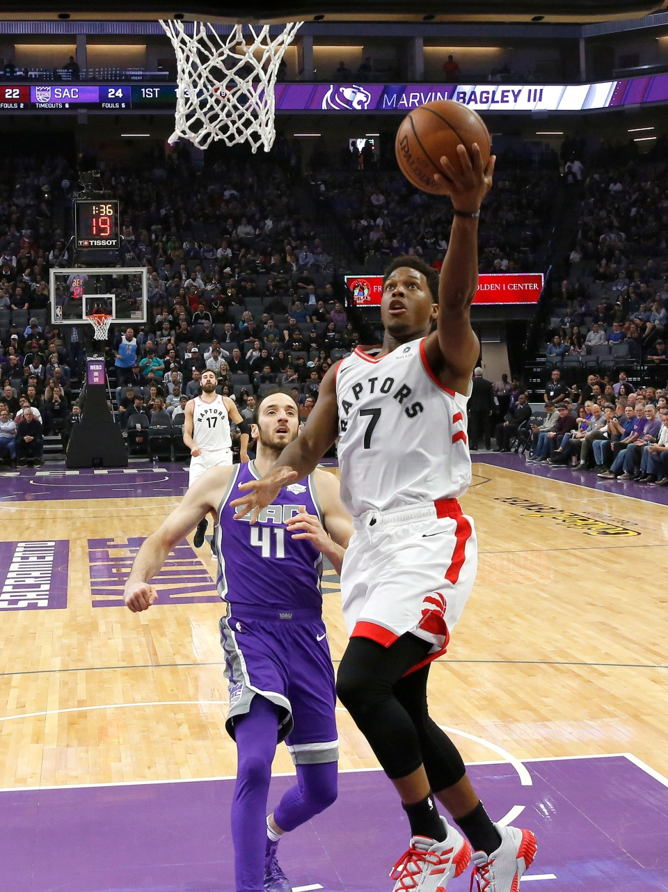 Toronto Raptors guard Kyle Lowry, right, goes to the basket as Sacramento Kings center Kosta Koufos, left, looks on during the first quarter of an NBA basketball game Wednesday, Nov. 7, 2018, in Sacramento, Calif. (AP Photo/Rich Pedroncelli)