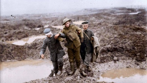 Canadian and German wounded help one another through the mud during the capture of Passchendaele. (Vimy Foundation / Library and Archives Canada)