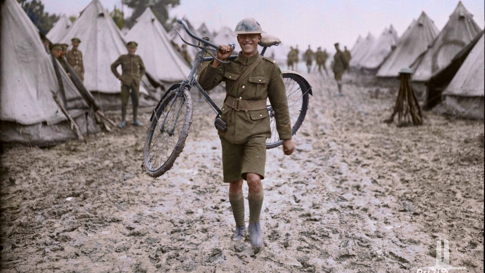 A Canadian messenger carries his 'horse,' August, 1917. (Vimy Foundation / Library and Archives Canada)