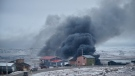 A fire burns at a Northmart store in Iqaluit, Nunavut on Thursday, November 8, 2018. THE CANADIAN PRESS/Frank Reardon
