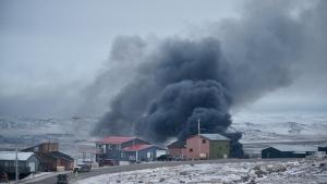 A fire burns at a Northmart store in Iqaluit, Nunavut on Thursday, November 8, 2018. THE CANADIAN PRESS/Frank Reardon
